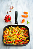 Colourful peppers in a pan