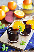 Beetroot and orange juice in glasses