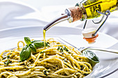 Spaghetti with basil pesto and olive oil