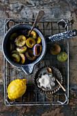 Preparation of plums Bleue de Belgique with sugar and lemon