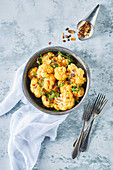 Yellow cauliflower with almond flakes and thyme