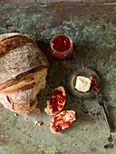 Bread with strawberry jam and butter