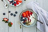 Yoghurt with berries, pomegranate and seeds