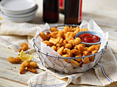 Fried breaded shrimp with ketchup