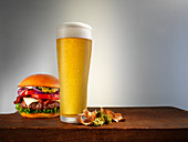A cheeseburger and a glass of beer