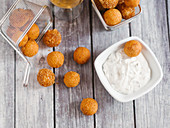Fried cheese balls with a yoghurt dip
