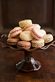 Various french macarons on a cake stand
