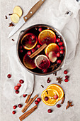 Non-alcoholic mulled wine with cranberries, orange slices and spices