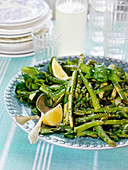 Asparagus salad with green asparagus, lemons and basil