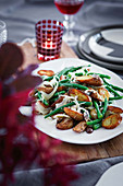 Green beans with fennel, crispy potatoes, olives and anchovies