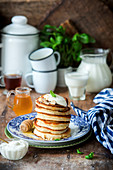 Pancakes with sour cream and honey