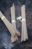 Three bundles of soba noodles made from buckwheat