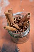 Cinnamon sticks in a glass jar