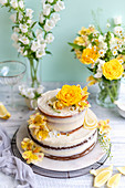 Two-tier wedding cake with lemon and elderflower cream with flower decoration