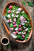 Roasted radish salad with arugula and bulgur