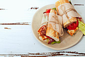Fresh baguette sandwiches bahn-mi styled with bacon, roasted cheese, tomatoes and lettuce