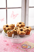 Sunflower muffins on a cake stand