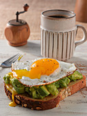 Toast with a fried egg and avocado