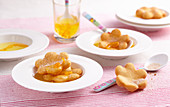 Deep-fried, sweet pastry flowers with orange syrup
