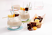 Coffee-milk drinks with coffee liqueur, milk and cream served with chocolate cake