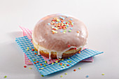 A carnival doughnut decorated with sugar confetti