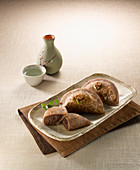 Asian millet pasties served with sake (Japan)