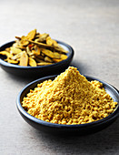 Curry powder and turmeric roots