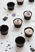 Chocolate buttercups with candied violets