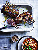 Roasted lamb rack with white beans and black garlic aioli
