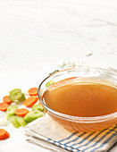 Vegetable stock in a glass bowl
