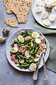 Asparagus and quail egg salad with dried focaccia