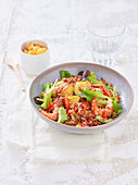 Red rice salad with prawns, celery and peaches