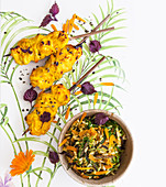 Chicken skewers with a yoghurt and turmeric marinade served with wild rice pilau
