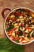 Vegetable soup with kale, white beans, potatoes, carrots and tomatoes