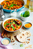 Vegetarian curry with chickpeas, bean and pumpkin