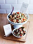 Pasta salad with coronation chicken and Greek mushroom salad