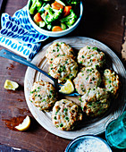Fish cakes with vegetables and lemon
