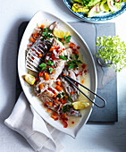 Mackerel fillets with peppers, carrots, coriander leaves and lemon