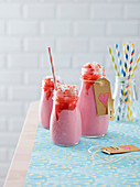 Strawberry milkshake with strawberries coulis and strawberry basier
