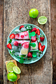 Mohito popsicles with lime, strawberry and mint