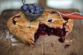 Freshly baked blueberry pie, sliced