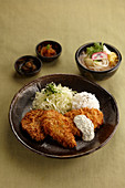 Breaded pork chops with coleslaw and rice (Asia)