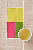 A bowl of green tea on a Jogakbo patchwork cloth (Korea)