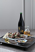 Grilled ribs with sesame sauce salad and wine (Korea)