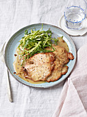 Pork escalope with fennel flowers, and puntarelle and rocket salad