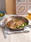 Veal escalopes with bacon and courgette