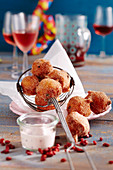 Sweet, deep-fried quark balls with lingonberry yoghurt dip