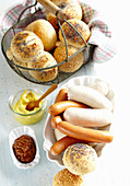 Mini sausages with mustard and bread rolls