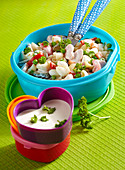 Elbow macaroni salad with heart-shaped pieces of ham and a yoghurt dressing