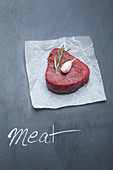 Beef tenderloin with garlic and rosemary on parchment